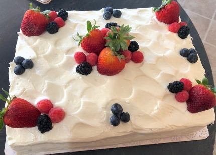 Photo of a white cassata cake with strawberries