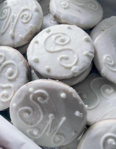 Photo of white sugar cookies with name initials for wedding anniversary