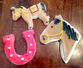 Photo of sugar cookies in the shape of a horse and a horseshoe