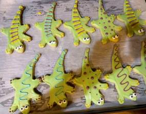 Photo of lizard shaped and colored sugar cookies