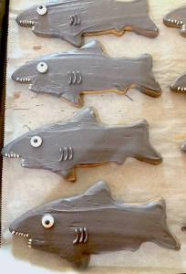 Photo of shark shaped and colored sugar cookies