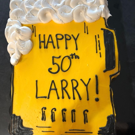 Photo of a beer pint shaped birthday cake with foam