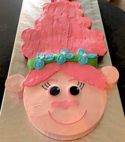 Photo of a female troll shaped pink cake