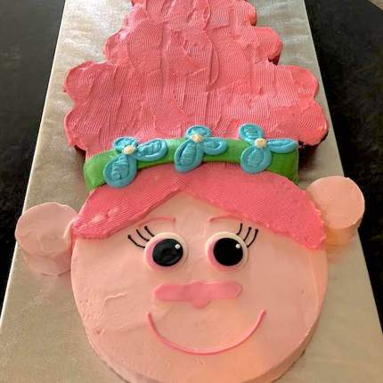 Photo of a female troll shaped pink cake